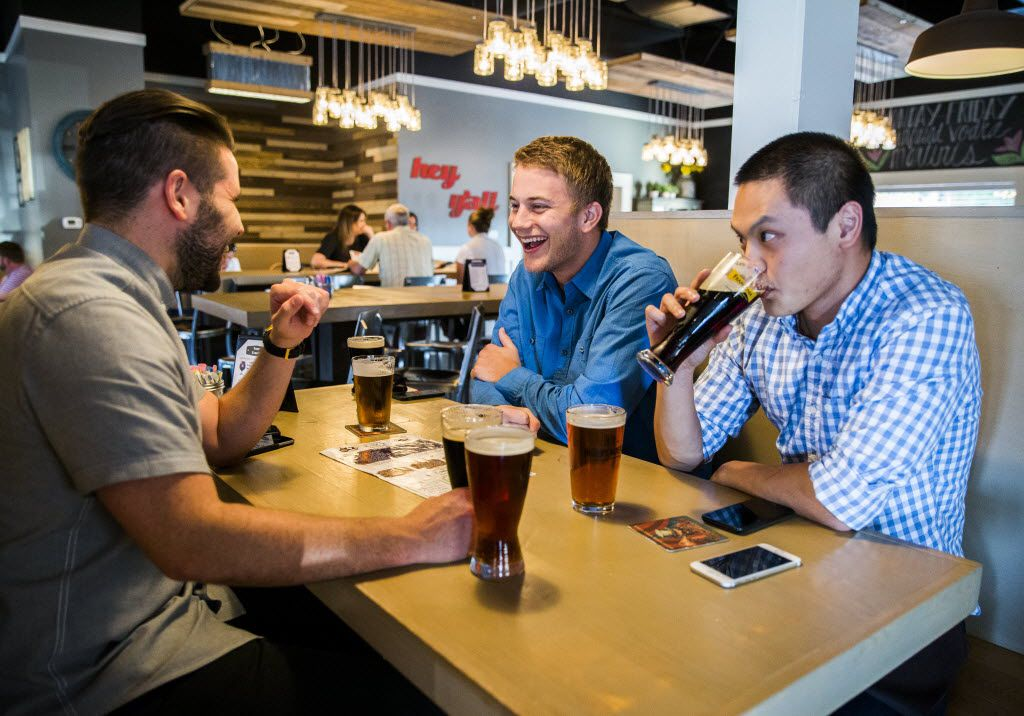 From left, Joseph Kabrane, Sam Alspach and Alex Ng enjoy beers and conversation on Wednesday, September 30, 2015 at FM Smokehouse in Irving.