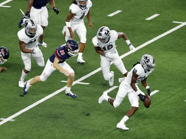 On a blocked extra point, Arlington Martin's Tramell Windham (20) picks up the ball and races the length of the field for a two-point score against Denton Ryan in the third quarter at AT&T Stadium in Arlington, Friday, September 25, 2020.