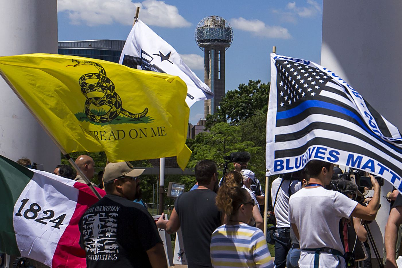 Gun rights advocates demonstrate outside Dallas City Hall at a rally organized by Open Carry Texas during the NRA Annual Meeting & Exhibits at the Kay Bailey Hutchison Convention Center on Saturday, May 5, 2018, in Dallas.