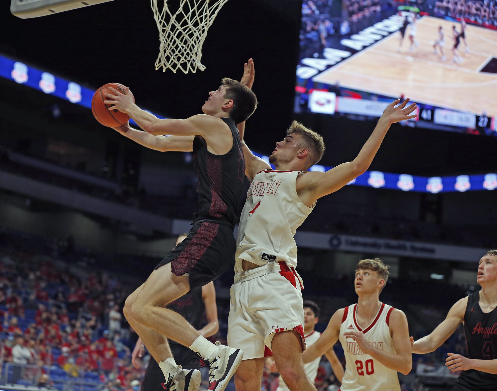 Argyle Eli Valentino #23 shoots  reverse layup on Huffman Hargrave Luke Thomas #4. UIL boys Class 4A basketball state championship game between Argyle and Hargrave on Saturday, March 13, 2021 at the Alamodome.