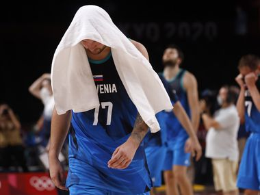 Slovenia's Luka Doncic (77) walks off the court dejected after losing to France 90-89 after a men's basketball semifinal at the postponed 2020 Tokyo Olympics at Saitama Super Arena, on Thursday, August 5, 2021, in Saitama, Japan. Slovenia will play in the bronze medal game. (Vernon Bryant/The Dallas Morning News)