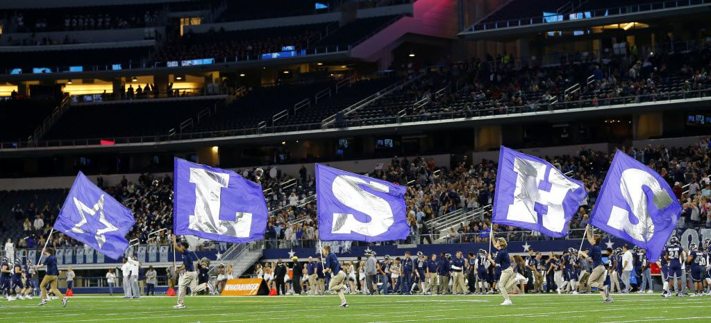 Frisco Lone Star flag team race across the field following a score against Lancaster in the second half of the 5A Div II Region II Final at AT&T Stadium in Arlington, Texas, Friday, December 4, 2015. Frisco Lone Star won 49-34. (Tom Fox/The Dallas Morning News)