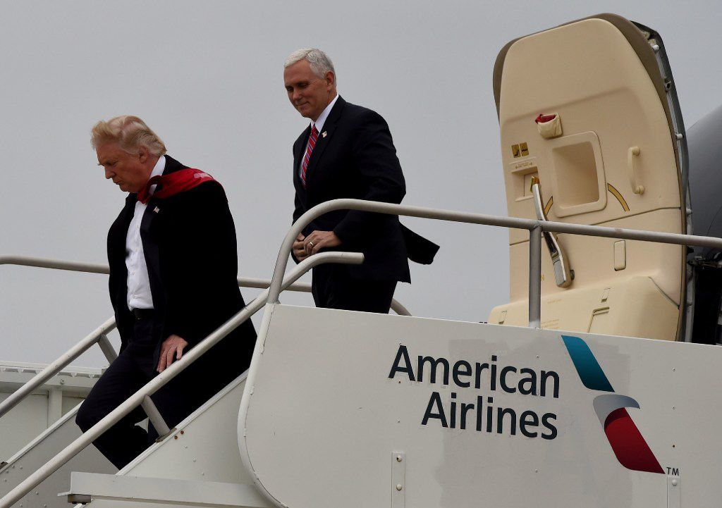 President-elect Donald Trump and Vice President-elect Mike Pence arrive Thursday at the airport before they go on to visit the Carrier air conditioning and heating company in Indianapolis, Indiana.