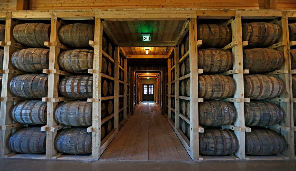 Oak barrels inside the Texas Tavern room at Firestone & Robertson Distilling Co.'s Whiskey Ranch.