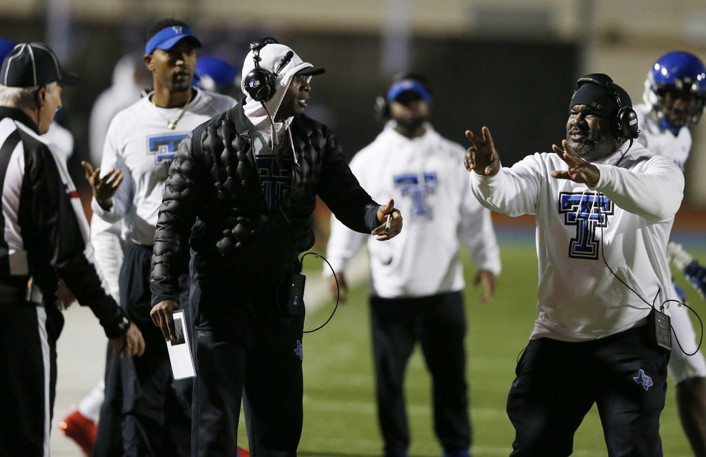Trinity Christian's head coach Andre' Hart and offensive coordinator Deion Sanders question a call from the officials in a game against Austin Regents  during the first half of play at the TAPPS Division II State Championship game at Waco Midway's Panther Stadium in Hewitt, Texas on Friday, December 6, 2019. (Vernon Bryant/The Dallas Morning News)