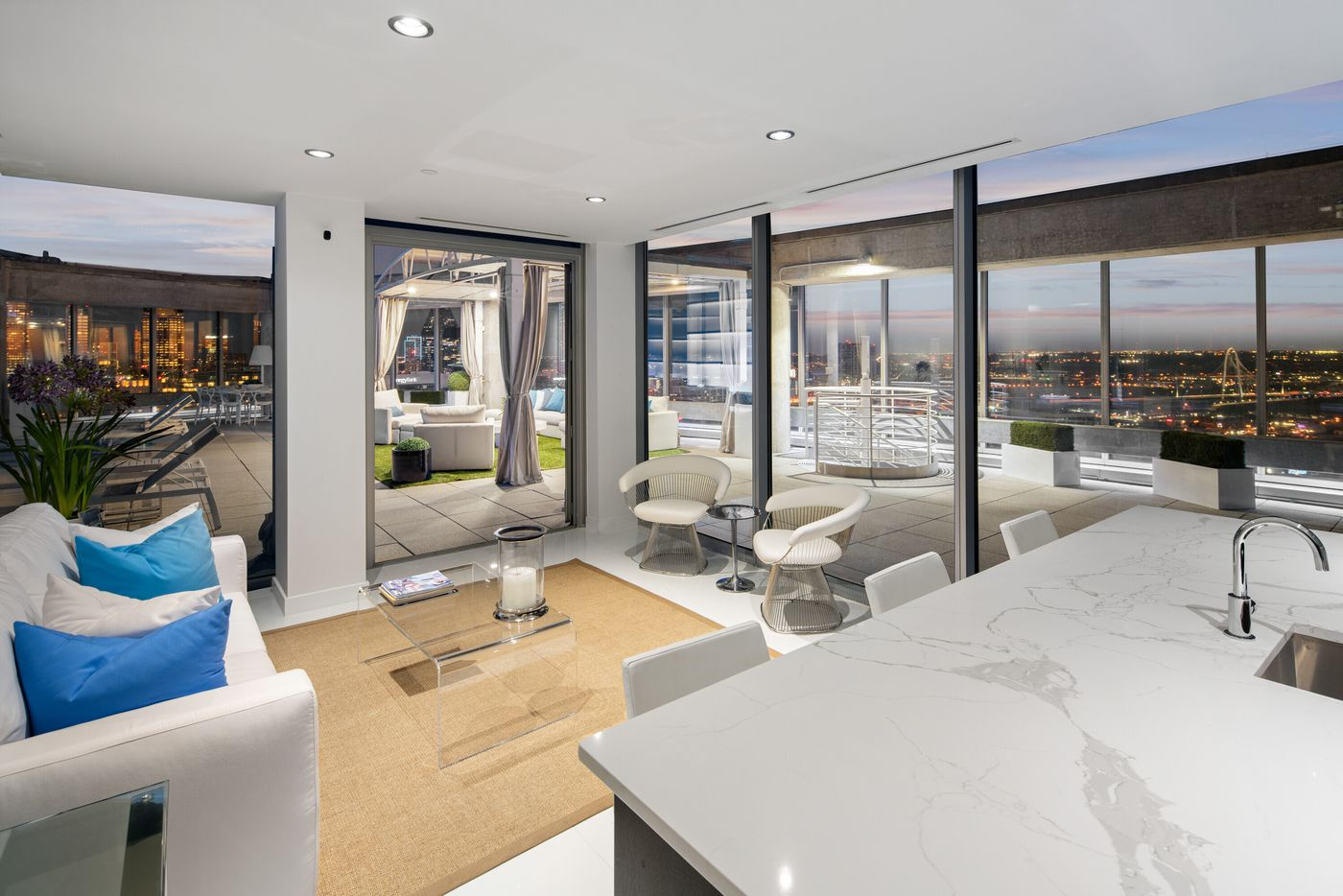 Take a look inside this two-level penthouse condo at the Azure, located at 2900 McKinnon St., Unit #3001 in Dallas.