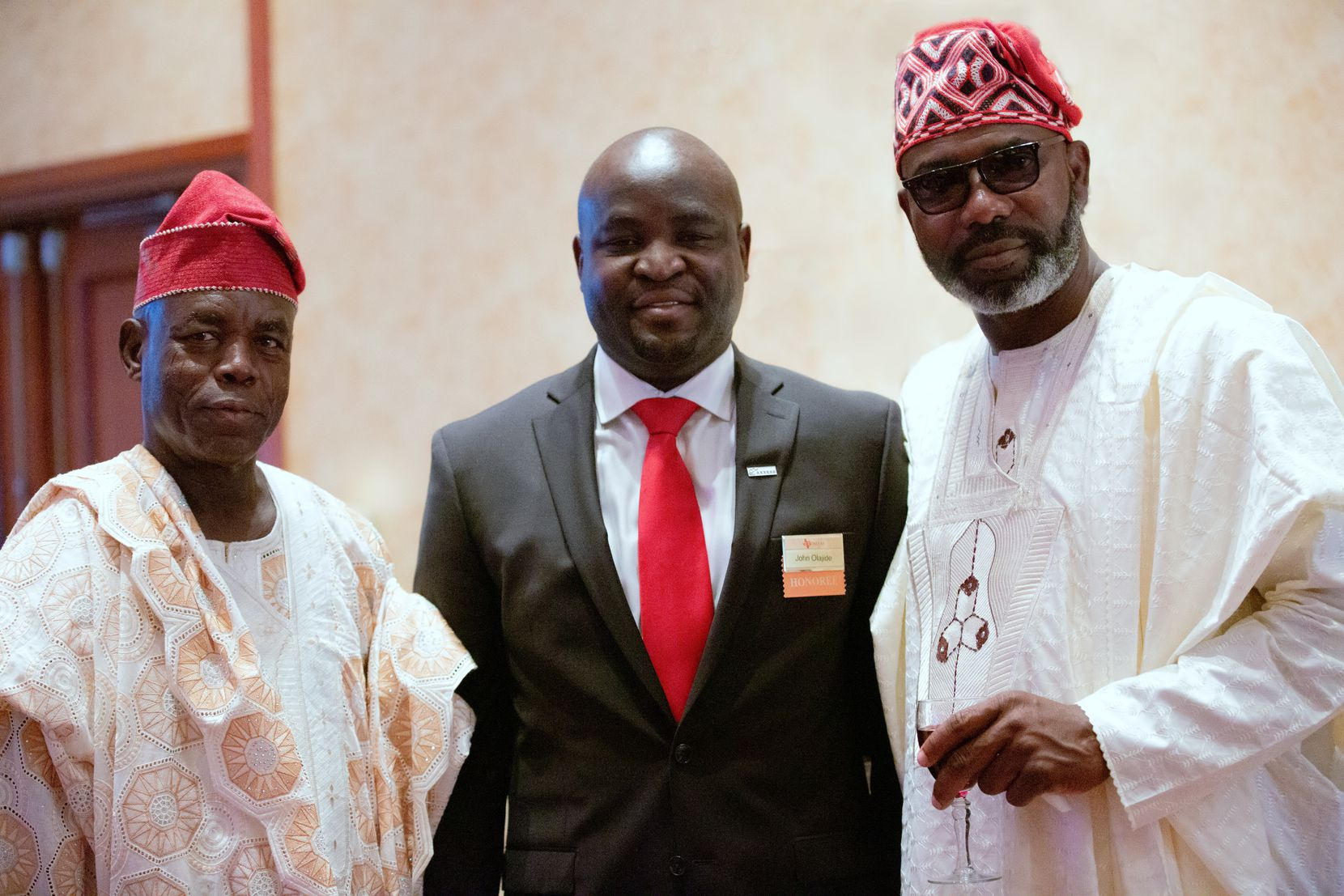 John Olajide, center, stands with his father, Daniel Olajide, right, and his uncle, Kunle Shonaike, at the Distinguished Alumnus reception at the University of Texas at Dallas in 2016.