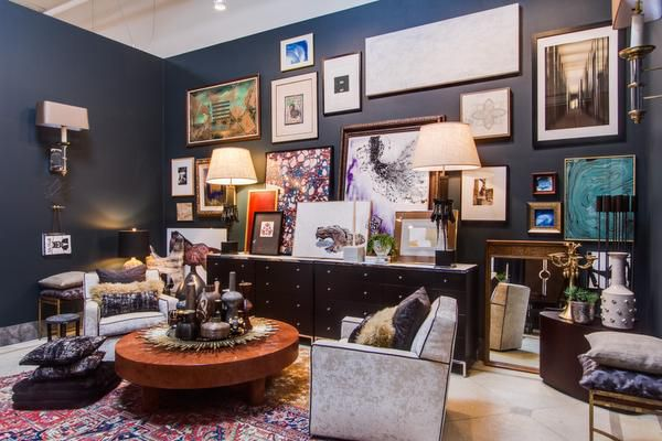 Swoon, the studio A massive gallery wall and low round table piled high with accessories create an eclectic atmosphere in this space that was inspired by a mix of East and West Coast sensibilities.