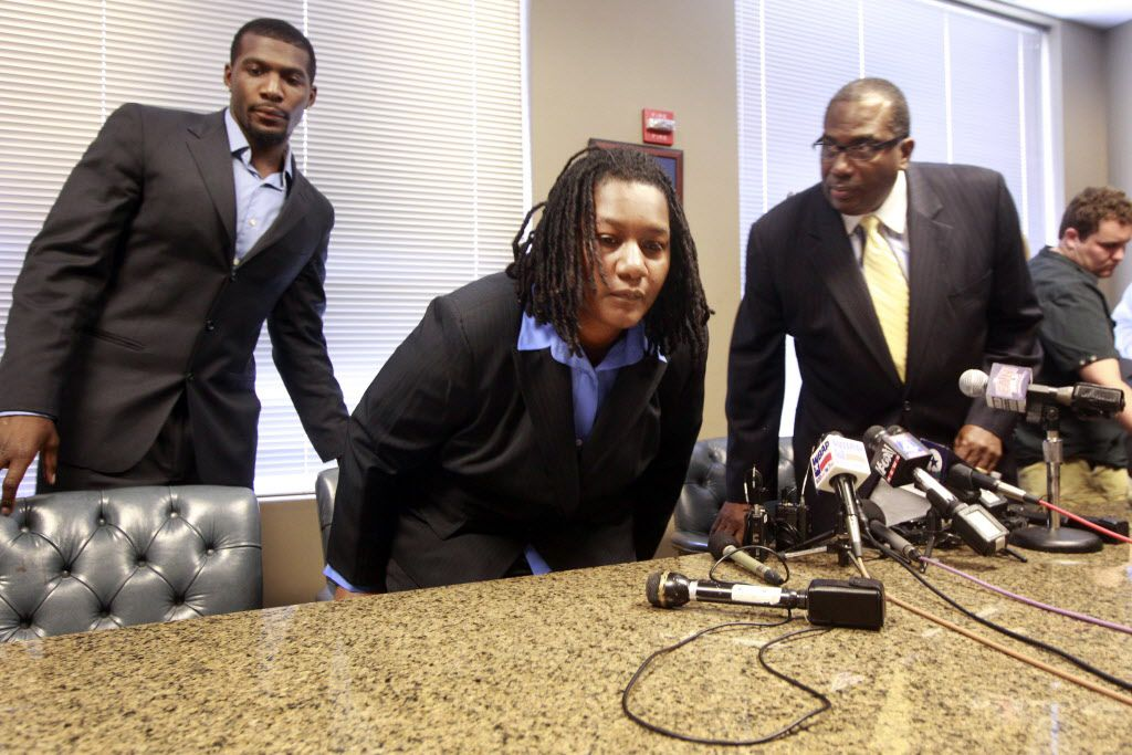 Dallas Cowboys player Dez Bryant, his mother Angela Bryant and attorney Royce West, at a press conference at West's office in Dallas, Texas on Tuesday, July 24, 2012. They said that no family violence occurred between Dez Bryant and his mother, and that the mother no longer wants to press charges. (Michael Ainsworth/ The Dallas Morning News)