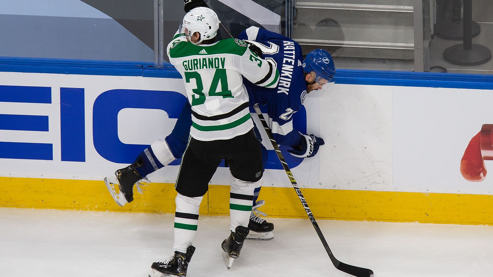 Denis Gurianov (34) of the Dallas Stars hits Kevin Shattenkirk (22) of the Tampa Bay Lightning during Game One of the Stanley Cup Final at Rogers Place in Edmonton, Alberta, Canada on Saturday, September 19, 2020.