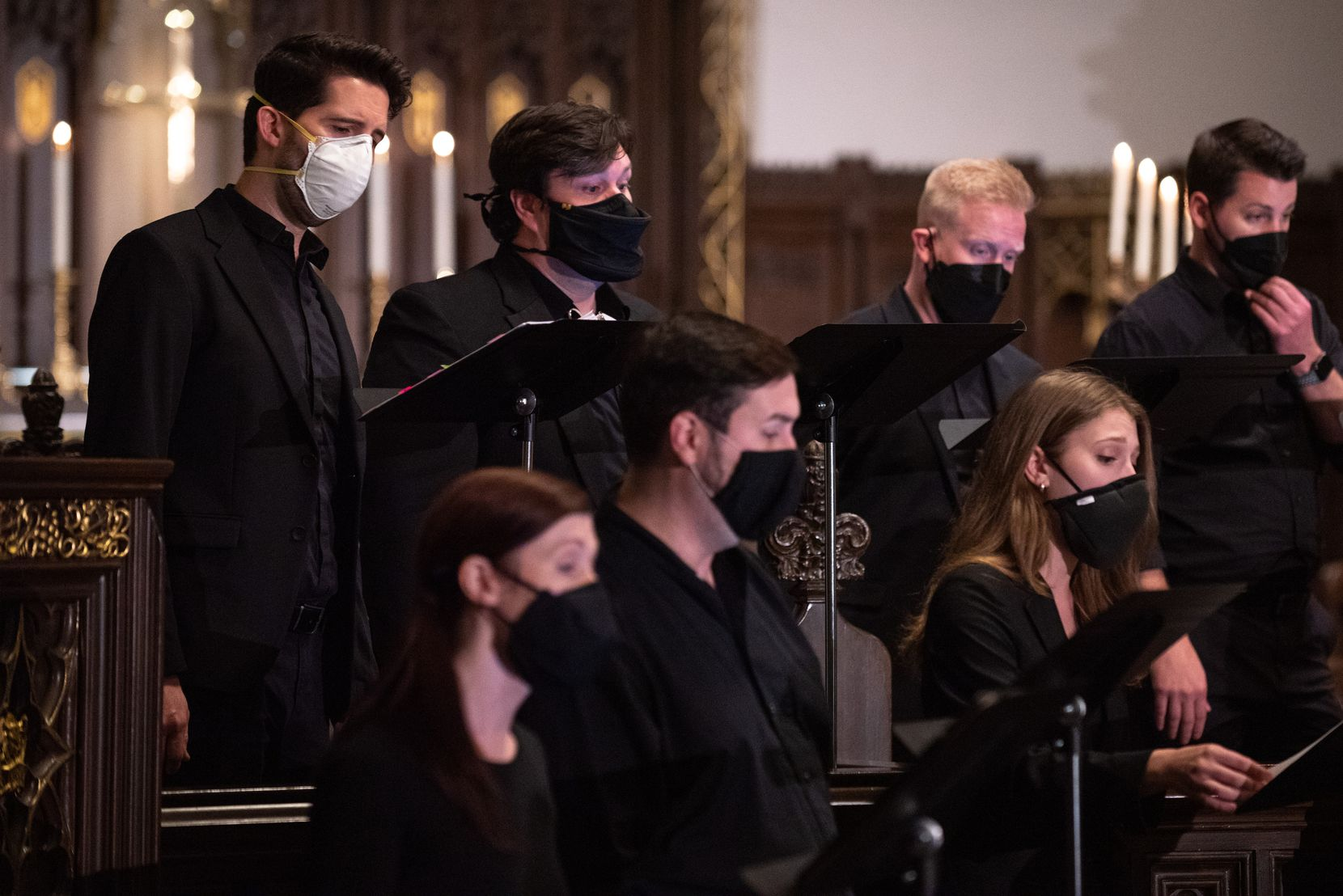 Chamber choir Incarnatus was somewhat muffled by their masks during a performance at Church of the Incarnation in Dallas.