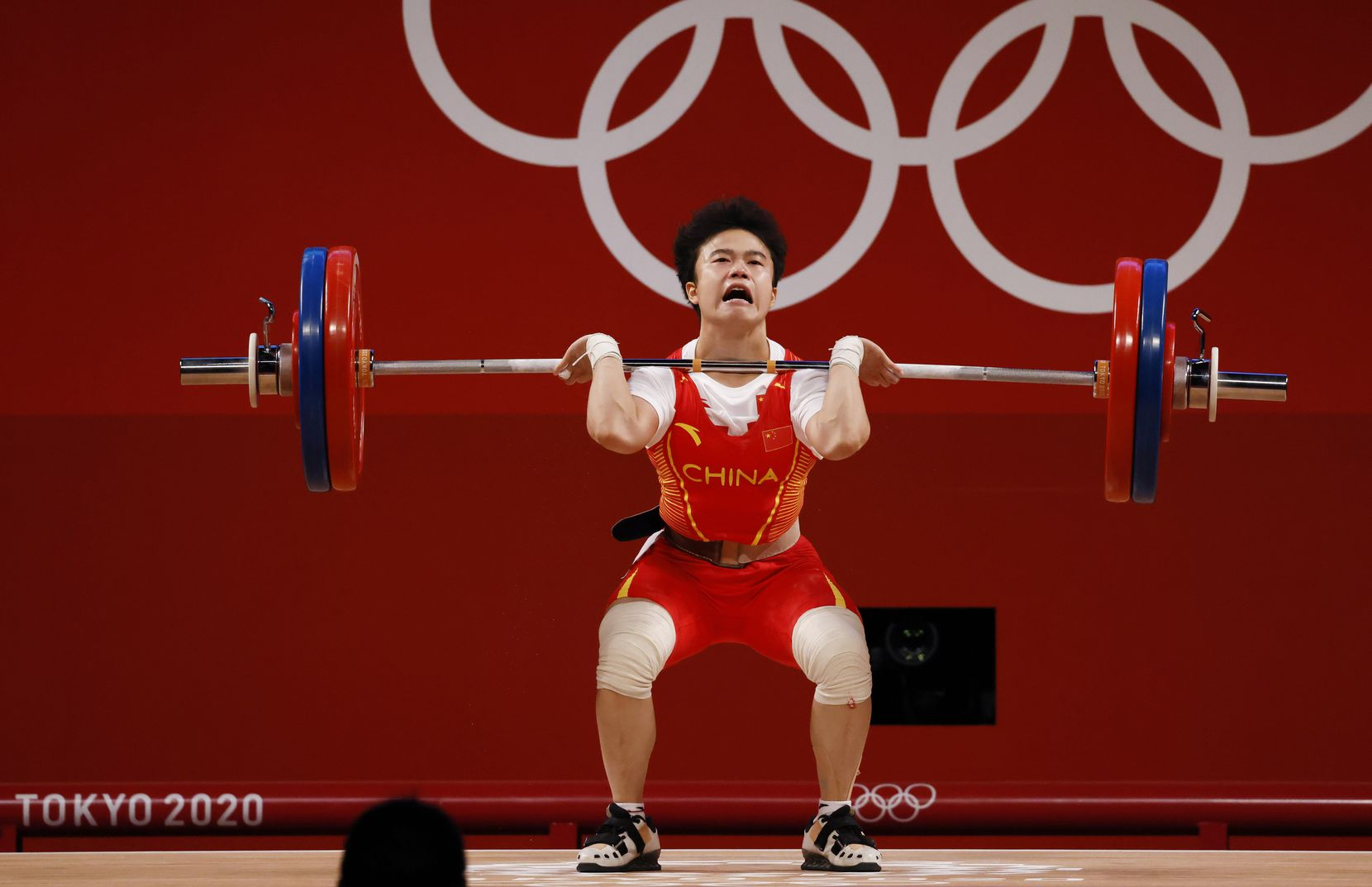 China's Zhihui Hou lifts 116 kg an Olympic record on her third attempt in the clean and jerk round of the women's 49 kg weightlifting final during the postponed 2020 Tokyo Olympics at Tokyo International Forum on Saturday, July 24, 2021, in Tokyo, Japan. Hou won a gold medal in this event. (Vernon Bryant/The Dallas Morning News)