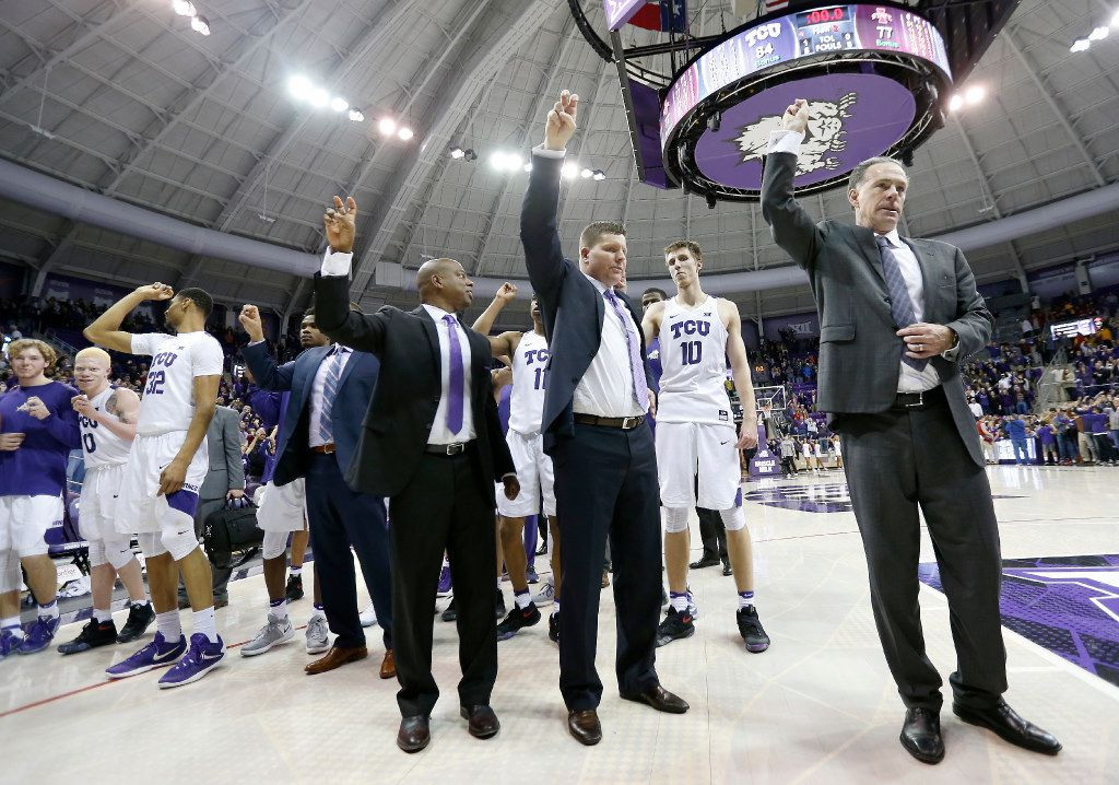 FILE - TCU Horned Frogs head coach Jamie Dixon (right) join the team celebrating a 84-77 win over the Iowa State Cyclones at Ed & Rae Schollmaier Arena in Fort Worth, Texas, Saturday, Jan. 14, 2017. (Jae S. Lee/The Dallas Morning News)