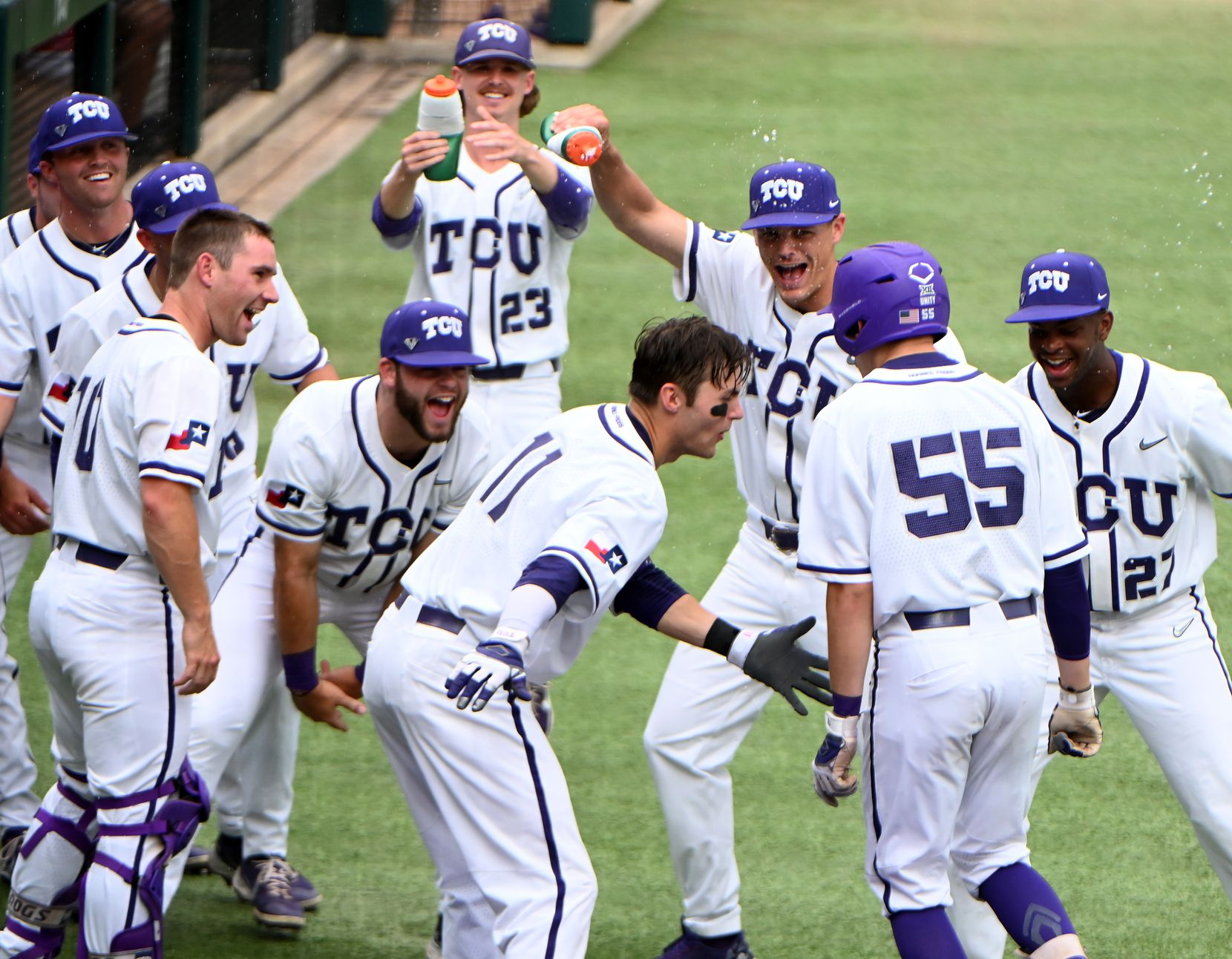 TCU players celebrate with Brayden Taylor (55) after his first inning home run during their game against  McNeese State in the Fort Worth Regional NCAA baseball tournament, Friday, June 4, 2021, in Fort Worth, Texas. (Matt Strasen/Special Contributor)