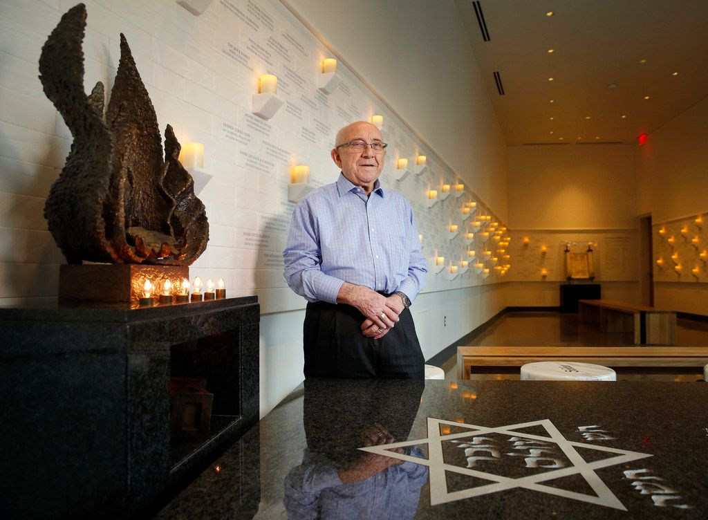 Holocaust survivor Max Glauben in The Memorial and Reflection Room, which honors Dallas-area victims of the Holocaust at the new Dallas Holocaust and Human Rights Museum in downtown Dallas. There are three tiles on the wall representing his family members who had died.