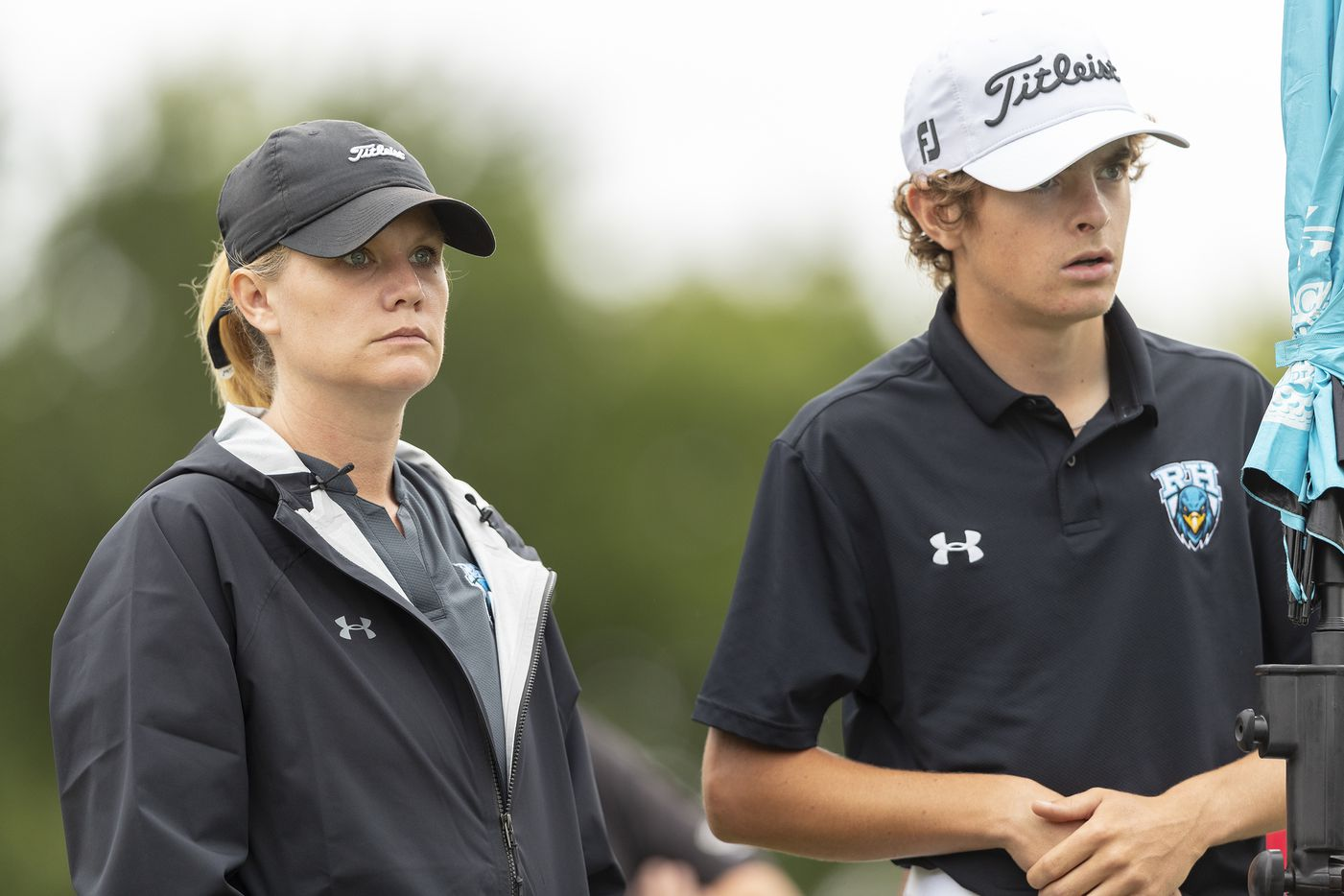 Prosper Rock Hill head coach head coach Taylur Reeder wait with Ryan Shellberg for others to hit from the 12th tee box during round 1 of the UIL Class 5A boys golf tournament in Georgetown, Monday, May 17, 2021. (Stephen Spillman/Special Contributor)