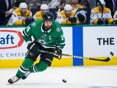 Dallas Stars left wing Jamie Benn (14) takes the puck during the first period of Game 6 of the first round of Stanley Cup Playoffs between the Dallas Stars and the Nashville Predators on Monday, April 22, 2019 at American Airlines Center in Dallas.
