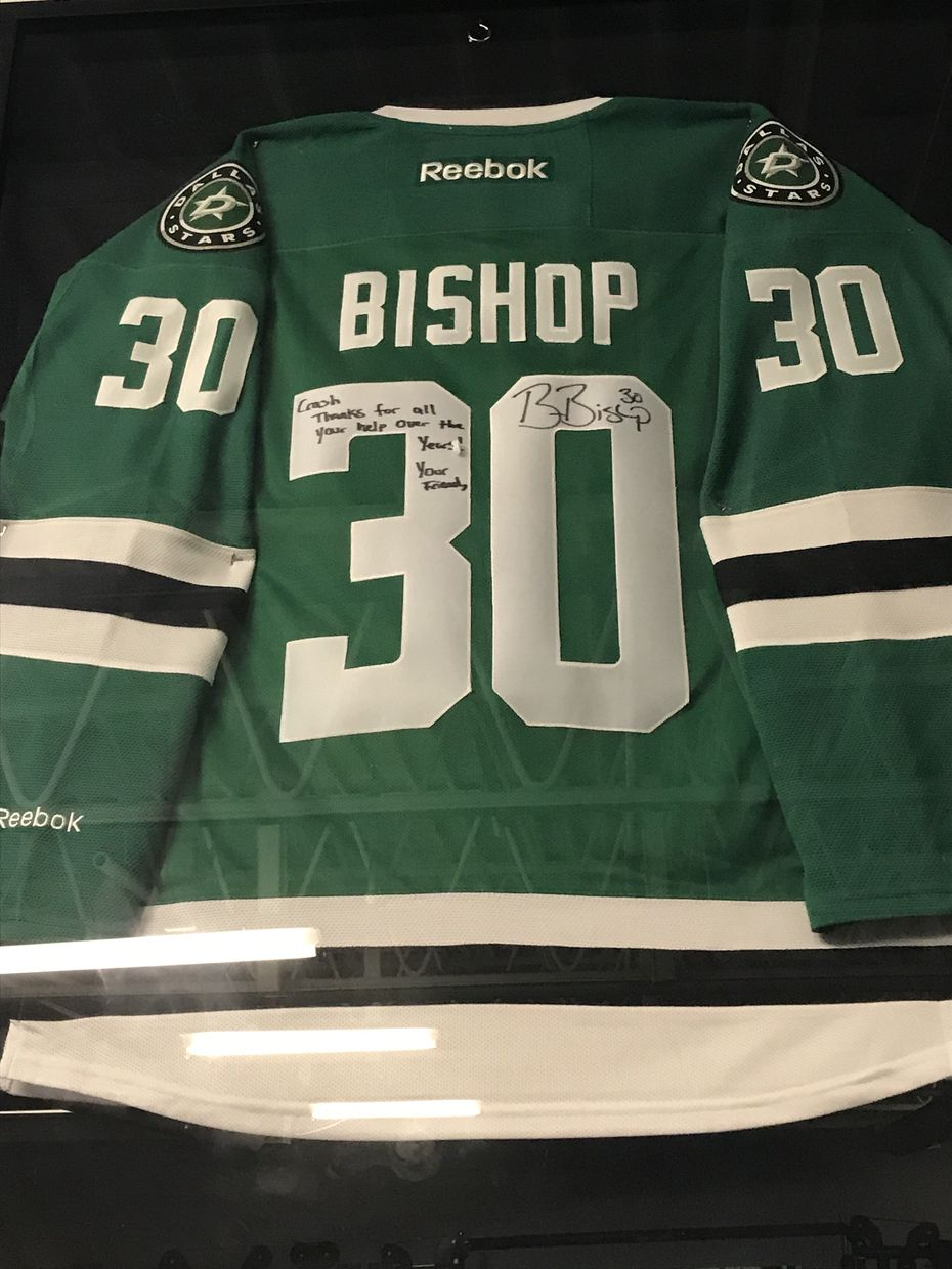 "Stars' goalie Ben Bishop's jersey is framed at Elevated Performance in St. Louis. Etched on the Jersey is a message to his former trainer Jon ""Crash"" Benne: ""Crash, Thanks for all your help over the years! Your friend."""