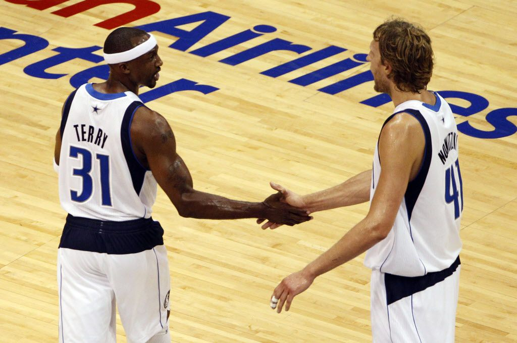 Dallas Mavericks power forward Dirk Nowitzki (41) congratulates Dallas Mavericks shooting guard Jason Terry (31) after a made basket in the fourth quarter during Game 4 of the NBA Finals at American Airlines Center Tuesday, June 7, 2011 in Dallas. Dallas defeated Miami 86-83 to tie the series 2-2. (Vernon Bryant/The Dallas Morning News)