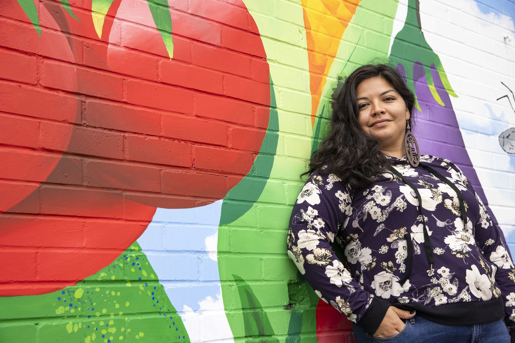 Danae Gutierrez, co-founder and executive director of the nonprofit Harvest Project Food Rescue, poses for a portrait at the 4DWN skatepark in Dallas.