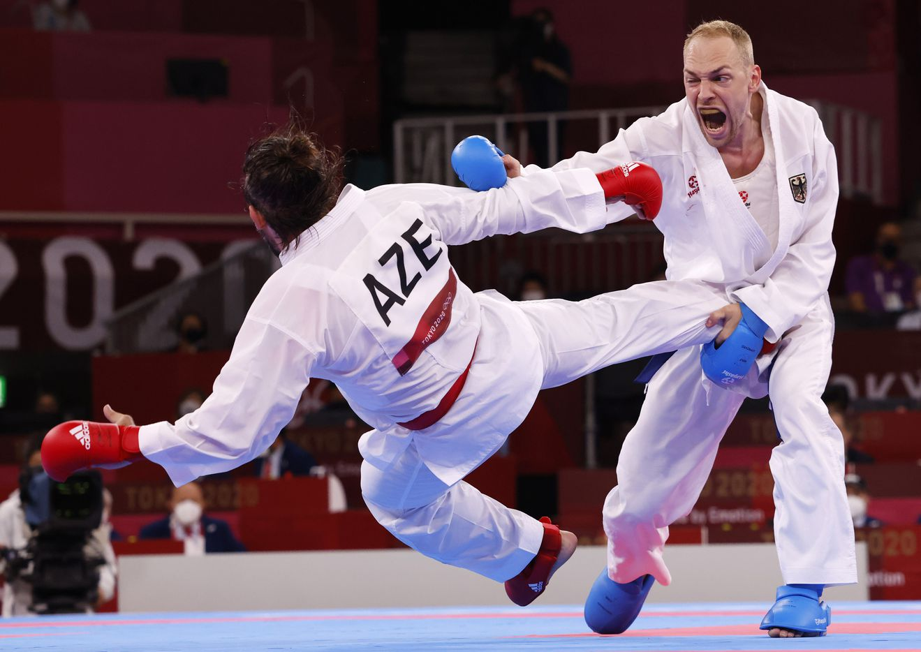 Germany's Noah Bitsch competes against Azerbaijan's Rafael Aghayev during the karate men's kumite -75kg elimination round at the postponed 2020 Tokyo Olympics at Nippon Budokan, on Friday, August 6, 2021, in Tokyo, Japan. Aghayev defeated Bitsch 2-1. (Vernon Bryant/The Dallas Morning News)