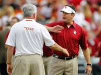 Texas Longhorns head coach Mack Brown and Oklahoma Sooners head coach Bob Stoops wish each other well during warmups before the Red River Rivalry at the Cotton Bowl in Dallas, Saturday, October 12, 2013.  (Tom Fox/The Dallas Morning News)