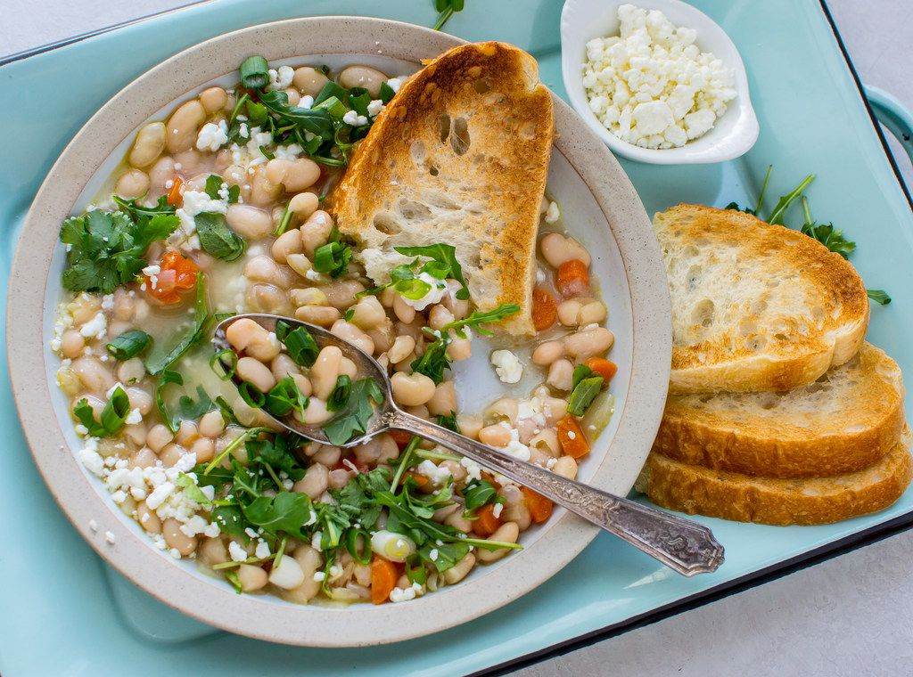 Instant Pot White Bean Soup with Greens and Goat Cheese is made with dried beans.