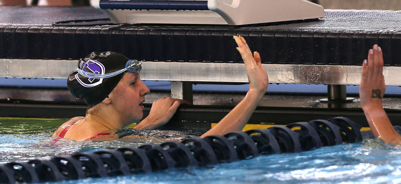 Frisco Independence Sienna Schellenger being congratulated after the 100 yard freestyle in UIL Girls 5A Finals on Tuesday, March 2,2021 at Bill Walker Pool and Josh Davis Natatorium