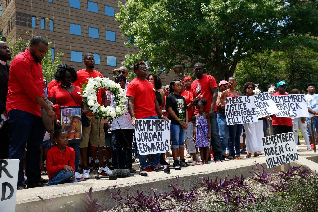 A crowd gathers, from left, including Lee Merritt, Charmaine Edwards, Odell Edwards on the steps of the Frank Crowley Courts Building in Dallas during a May rally remembering those killed by police, including Jordan Edwards.