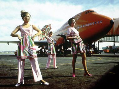 Braniff International Airways flight attendants modeled their Emilio Pucci-designed uniforms on the tarmac.