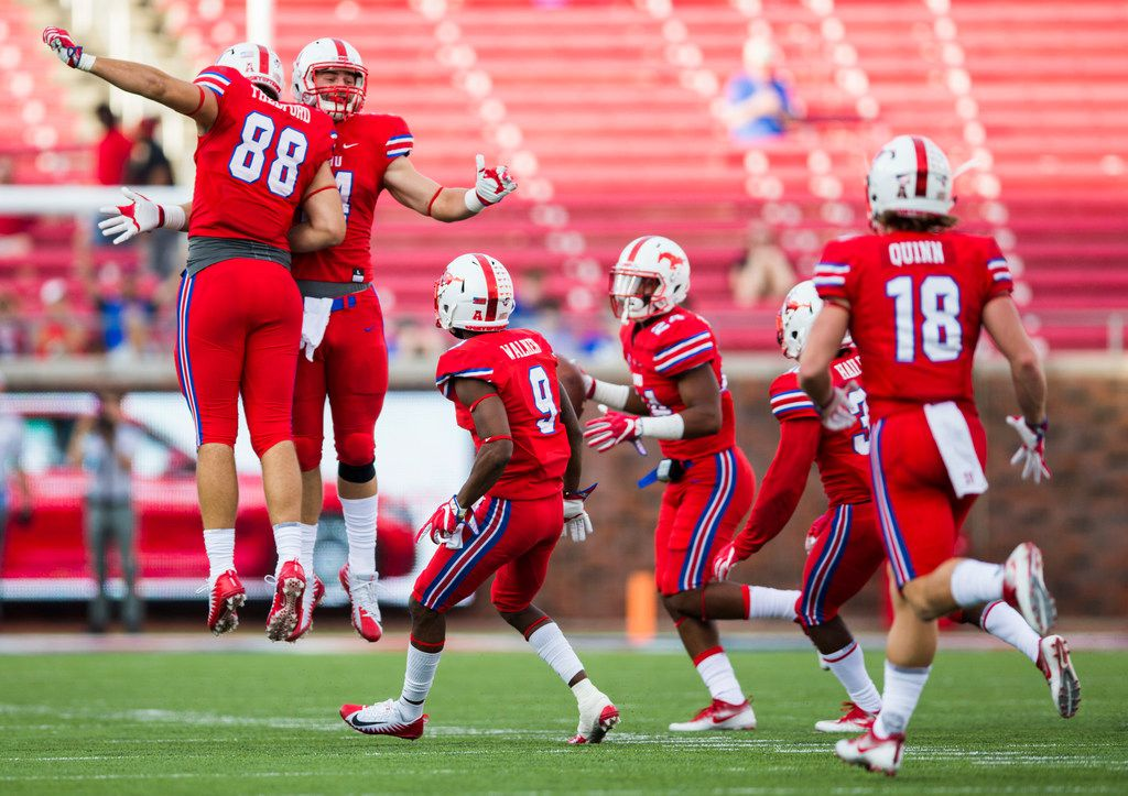 Southern Methodist Mustangs celebrate after safety Delano Robinson (24) recovered a fumble on a punt during the fourth quarter of a football game between the University of Connecticut and SMU Texas on Saturday, September 30, 2017 at SMU's Ford Stadium in Dallas. (Ashley Landis/The Dallas Morning News)