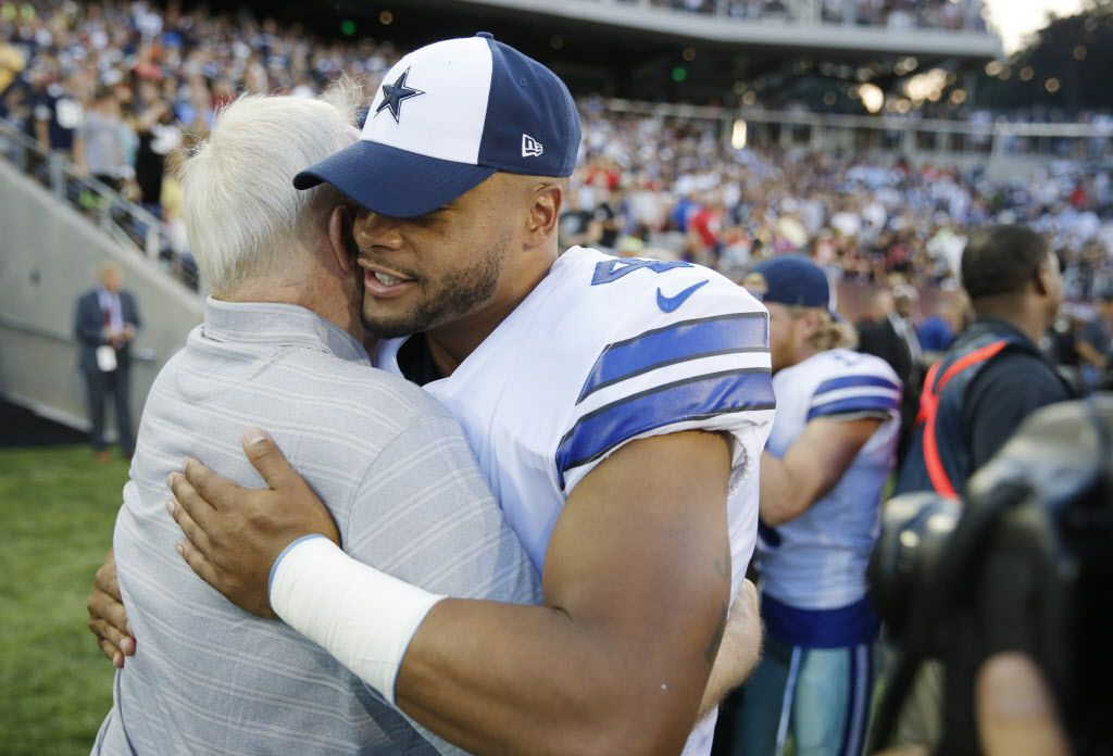 Dallas Cowboys owner and general manager Jerry Jones gets a hug from Dallas Cowboys quarterback Dak Prescott (4) before the start of the Hall of Fame Game between the Dallas Cowboys and Arizona Cardinals at Tom Benson Hall of Fame Stadium in Canton, Ohio on Thursday, August 3, 2017. Jones will be inducted into the Pro Football Hall of Fame this weekend.