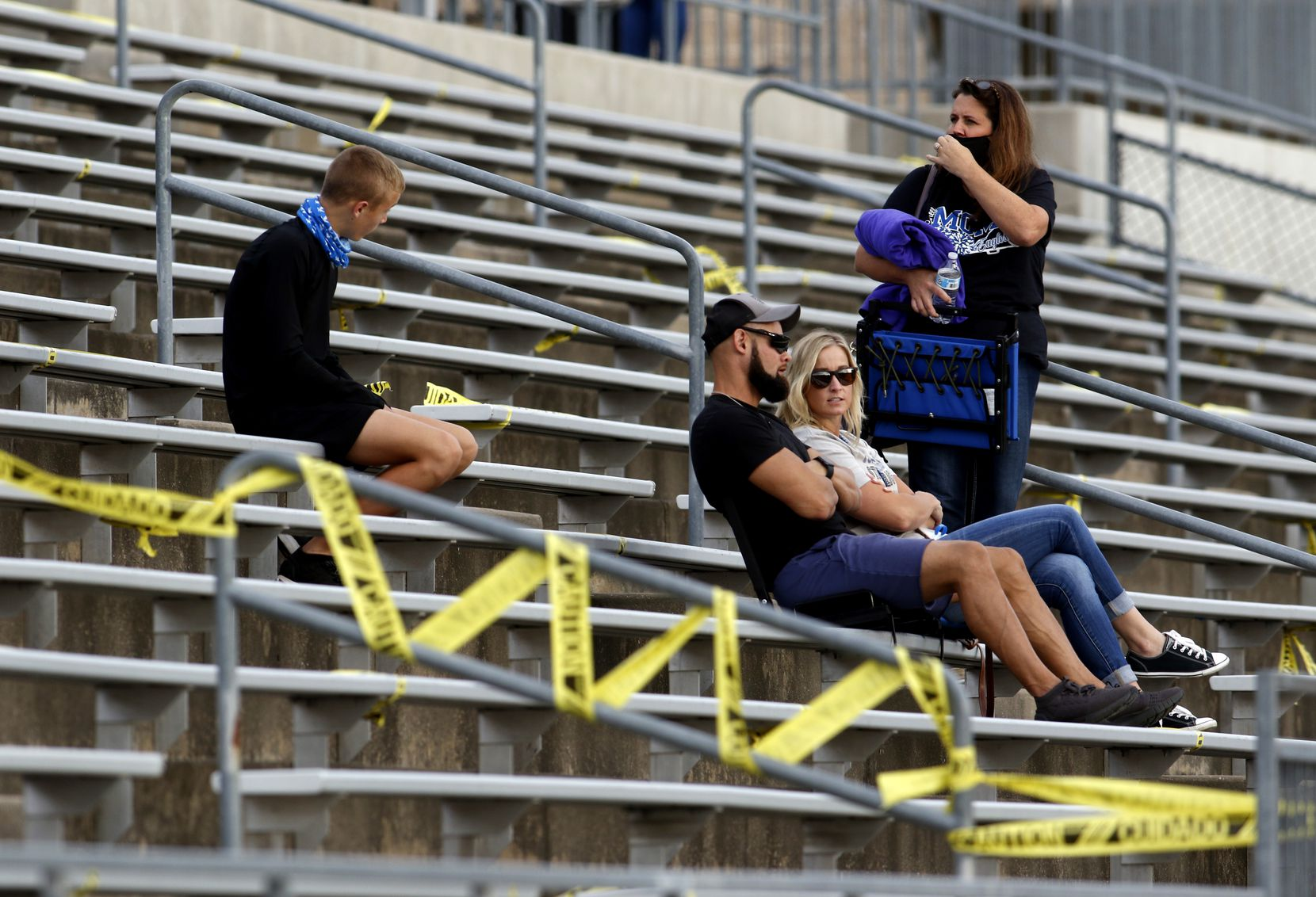 A group of Lindale fans await the opening kickoff of their scheduled  football game against Midlothian Heritage. The two teams played their Class 4A football game at Midlothian ISD Multipurpose Stadium in Midlothian on September 4, 2020. (Steve Hamm/ Special Contributor)