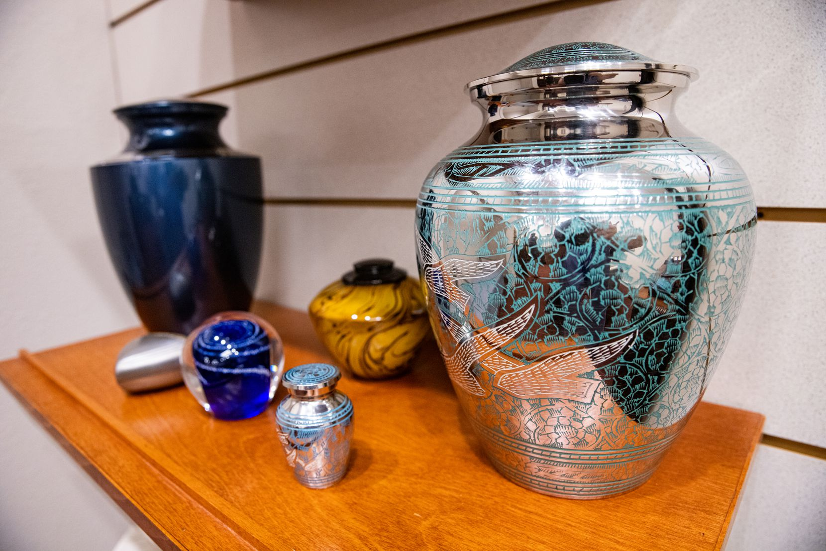 Urns on display at Ted Dickey West Funeral Home in Dallas.