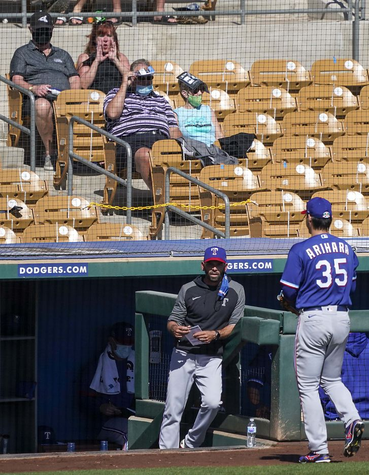 Chicago White Sox fans boo as Texas Rangers pitcher Kohei Arihara exits the game with the bases loaded and two outs — but having the inning end due to a spring training rule allowing defensive teams to end an inning as long as the pitcher has thrown at least 20 pitches — during the second inning of a spring training game against the White Sox at Camelback Ranch on Tuesday, March 2, 2021, in Phoenix, Ariz.