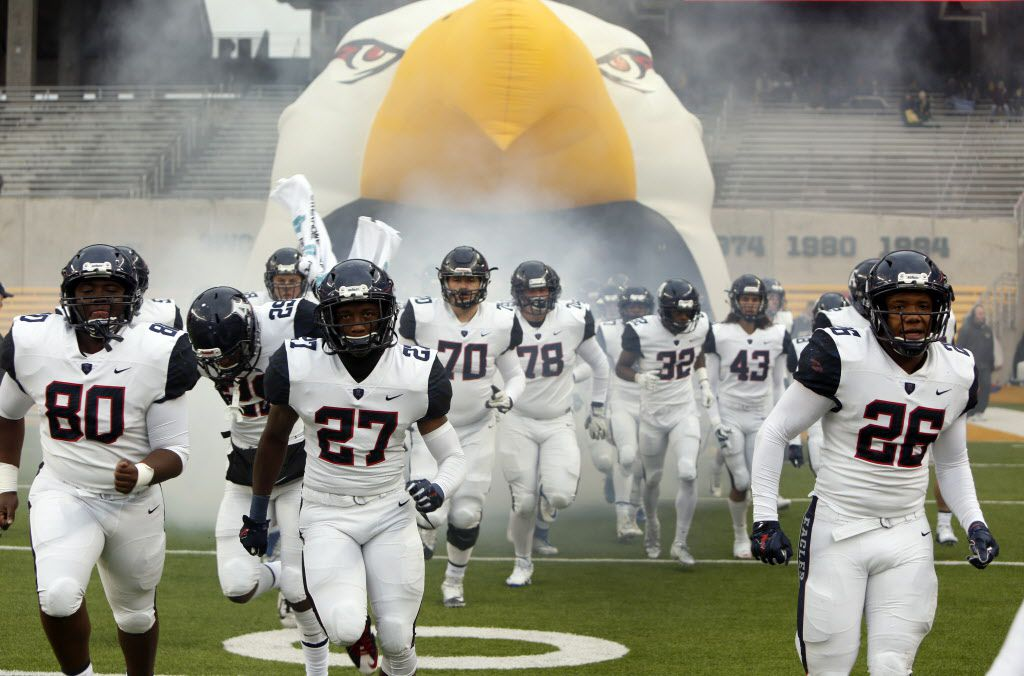 Allen Eagles players bolt onto the field from the team inflatable for the second half of their game against Waco Midway. The two teams played their Class 6A Division l Region ll final football playoff game at Baylor's McLane Stadium in Waco on December 8, 2018.  (Steve Hamm/ Special Contributor)  (NOTE: SPORTS requested this image be placed into the system for consideration to accompany a future feature on Allen Football.