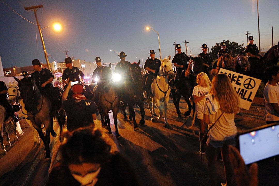 Mounted Dallas Police Department officers move protestors down Cadiz Street following a rally for presumptive Republican presidential nominee Donald Trump Thursday, June 16, 2016 at Gilley's in Dallas. (G.J. McCarthy/The Dallas Morning News)