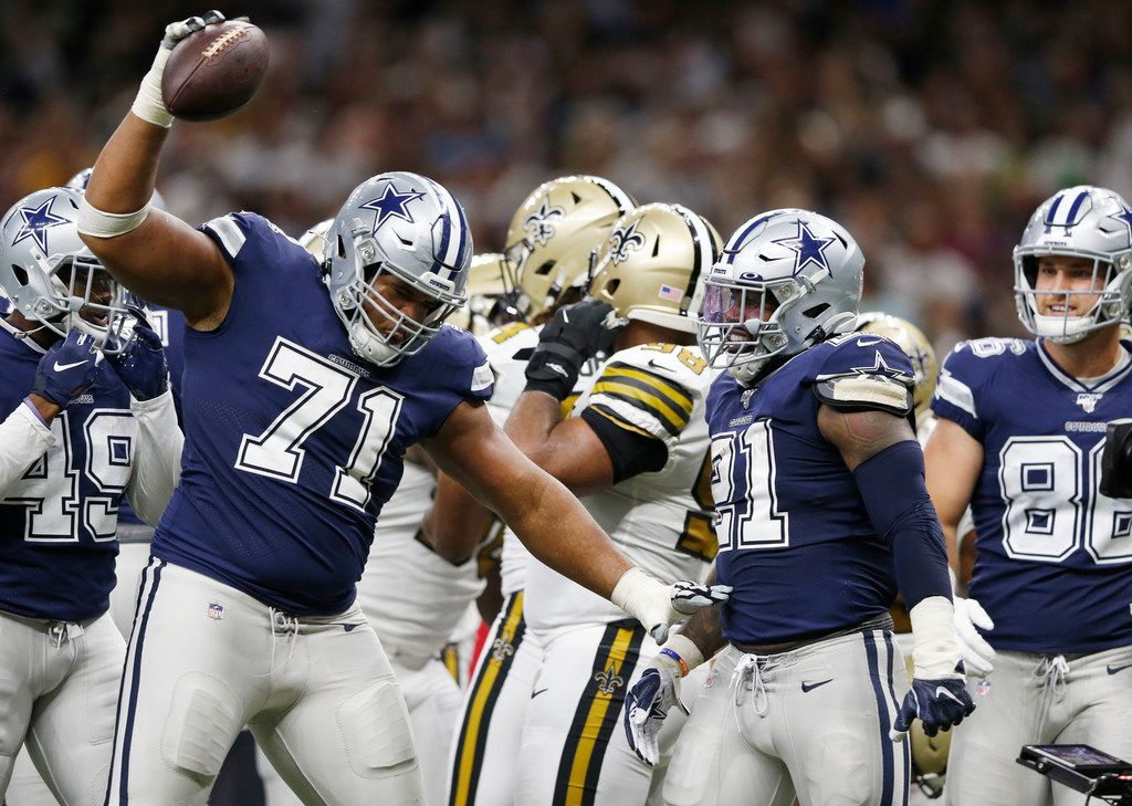 FILE - Cowboys offensive tackle La'el Collins (71) spikes the ball after running back Ezekiel Elliott (21) scored a touchdown in the second half of a game against the Saints in the Mercedes-Benz Superdome in New Orleans on Sunday, Sept. 29, 2019.