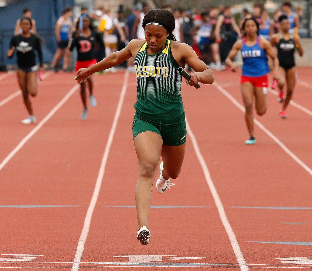 DeSoto's Ja'Era Griffin crosses the finish line first in the girls 4x200-meter relay at Saturday's Jesuit-Sheaner Relays. DeSoto won in 1:37.26.  (Stewart F. House/Special Contributor)