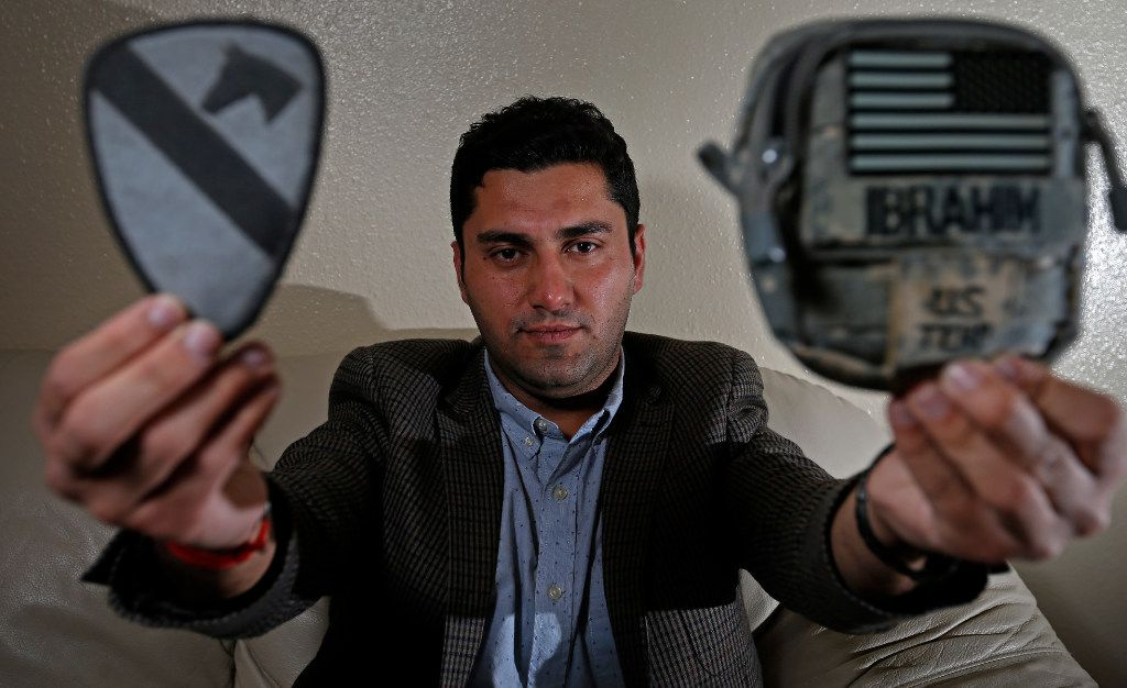 Ibrahim Yousif displays the military patch and porch at his apartment in Plano, Texas, Sunday. He served for almost three years as an interpreter for the U.S. Army in Iraq. (Jae S. Lee/Staff Photographer)