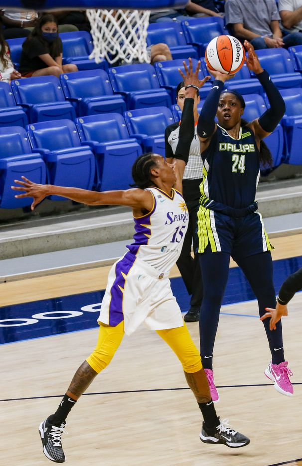 Dallas Wings guard Arike Ogunbowale (24) goes for a shot against Dallas Wings guard Allisha Gray (15) during the second quarter at College Park Center on Tuesday, June 1, 2021, in Arlington. (Juan Figueroa/The Dallas Morning News)