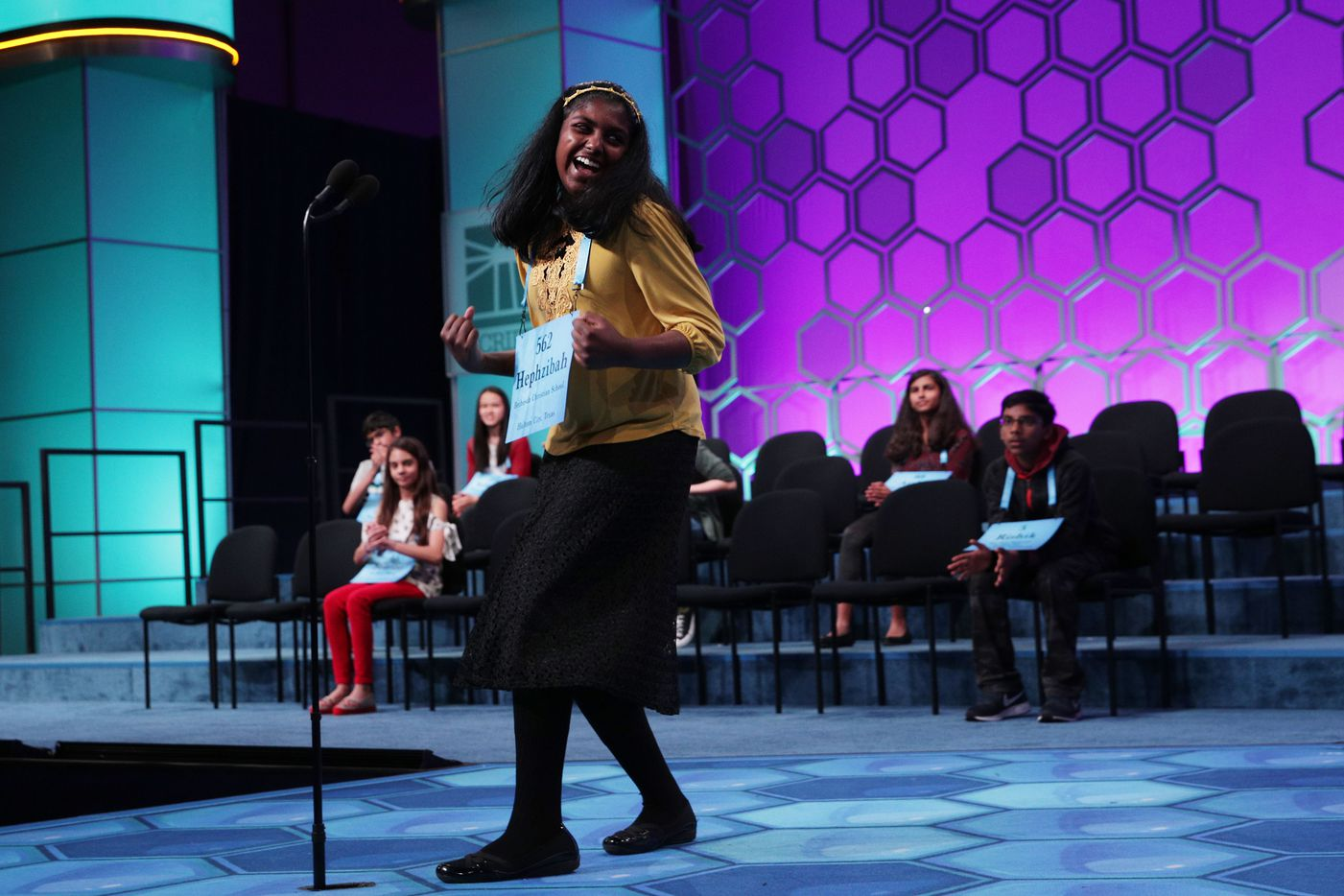 """NATIONAL HARBOR, MARYLAND - MAY 30: Hephzibah Sujoe of Fort Worth, Texas, celebrates after she correctly spelled the word """"yponomeutid"""" during round eight of the Scripps National Spelling Bee at the Gaylord National Resort & Convention Center May 30, 2019 in National Harbor, Maryland. Students from across the country and around the world compete in the spelling competition, which started in 1925. (Photo by Alex Wong/Getty Images)"""