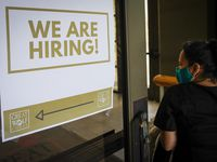 A sign directs job candidates to a hiring event at Great Wolf Lodge Grapevine on Tuesday, May 4, 2021, in Grapevine. The job fair was held to fill more than 160 positions locally.