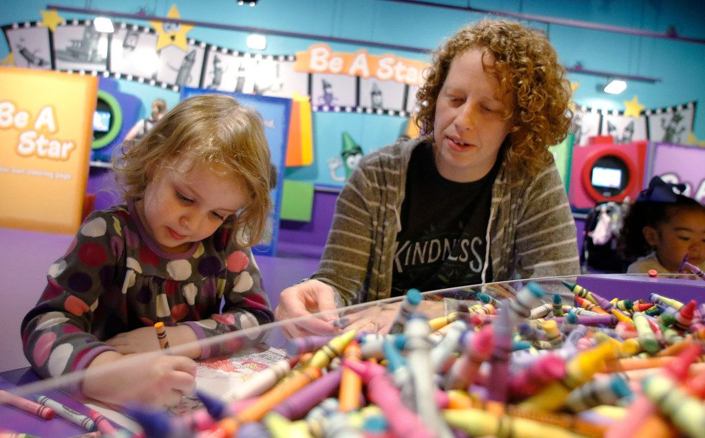 Anna Horton, 3, colors as her mother, Robin Horton watches during the grand opening of the Crayola Experience Plano.