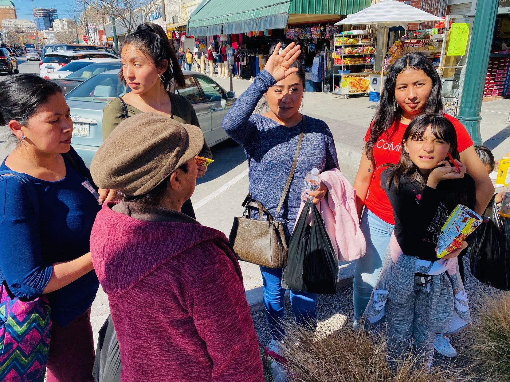 The Lerma family drove about 35 miles to meet grandmother Blanca Trejo and an aunt and cousin. They are trying to adjust to the new normal of social distancing.