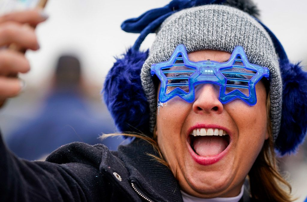 Elsa Madrid of Grapevineas takes a selfies as fans tailgate before an NFL football game at AT&T Stadium on Thursday, Nov. 28, 2019, in Arlington. (Smiley N. Pool/The Dallas Morning News)