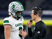 Southlake Carroll quarterback Quinn Ewers (3) talks with head coach Riley Dodge during the fourth quarter of a Class 6A Division I area-round high school football playoff game between Southlake Carroll and DeSoto on Friday, November 22, 2019 at AT&T Stadium in Arlington.