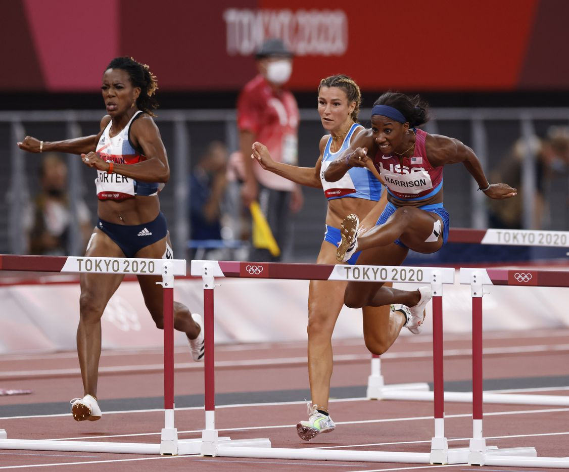 USA's Kendra Harrison runs in the women's 100 meter hurdles semifinal during the postponed 2020 Tokyo Olympics at Olympic Stadium, on Sunday, August 1, 2021, in Tokyo, Japan. Harrison finished with a time of 12.51 seconds to advance to the final. Next to her is Great Britain's Tiffany Porter and Italy's Luminosa Bogliolo. (Vernon Bryant/The Dallas Morning News)