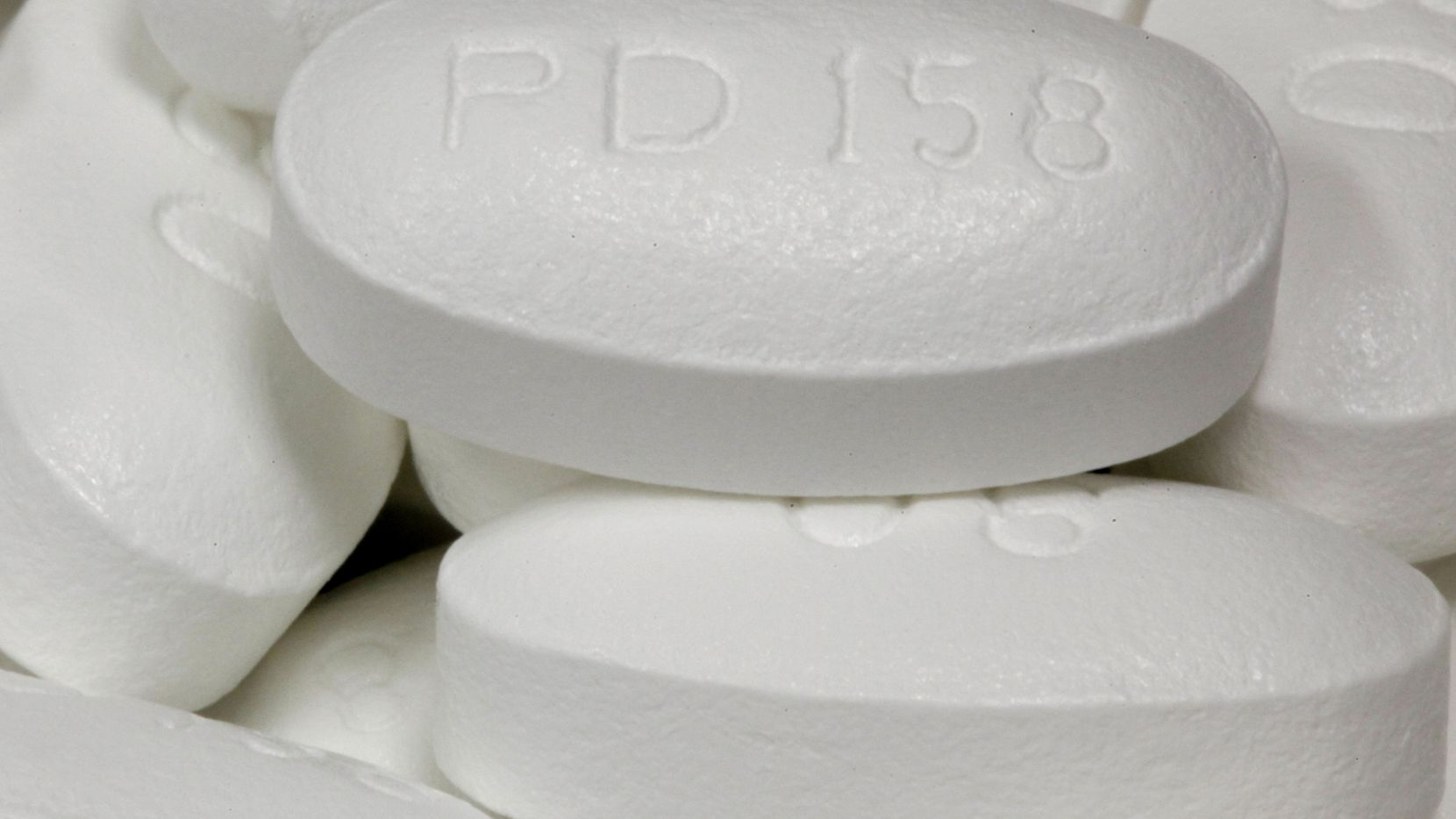 HOLD FOR RELEASE UNTIL 8:30 P.M. EDT ON THURSDAY, APRIL 24, 2014; THIS STORY MAY NOT BE PUBLISHED, BROADCAST OR POSTED ONLINE BEFORE 8:30 P.M. EDT ON THURSDAY, APRIL 24, 2014 - FILE - This June 14, 2011 file photo shows the drug Lipitor at Medco Health Solutions Inc., in Willingboro, N.J. In a study published online Thursday, April 4, 2014 in JAMA Internal Medicine, 10 years of U.S. data suggest cholesterol-lowering statins are giving patients a license to pig out. Calorie and fat intake increased among statin users during the decade - an indication that many patients might be abandoning heart-healthy lifestyles and assuming that drugs alone will do the trick, the study authors said. (AP Photo/Matt Rourke)