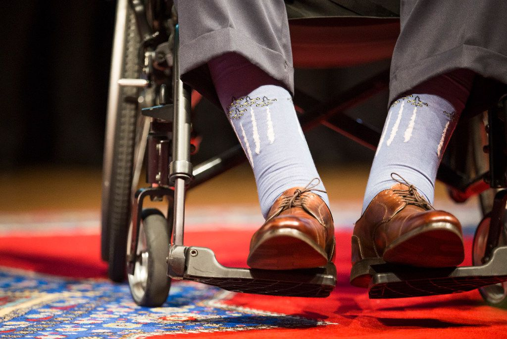Former President George H. W. Bush wears sock depicting airplanes in flight during a 75th Anniversary of Pearl Harbor commemoration at the George Bush Presidential Library on Wednesday, Dec. 7, 2016, in College Station, Texas. (Smiley N. Pool/The Dallas Morning News)